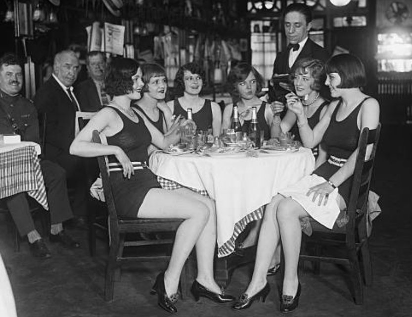 The experience concludes at Keens Steakhouse. In 1925, Mildred Lunney, Margy Martin, Helen Sheldon, Catherine Frey, Bobbie Powers and Edith Babson sit in the restaurant,then named Keen's Chop House. The women arrived for lunch in swimming attire to challenge the restaurant's dress code.After some debate, Keen's manager Paul Henkel allowed the women to dine.