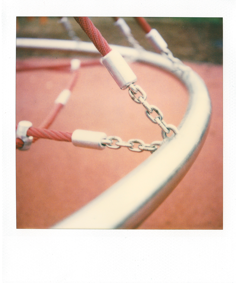 impossible blend film: original polaroid 600 with added pack filter.