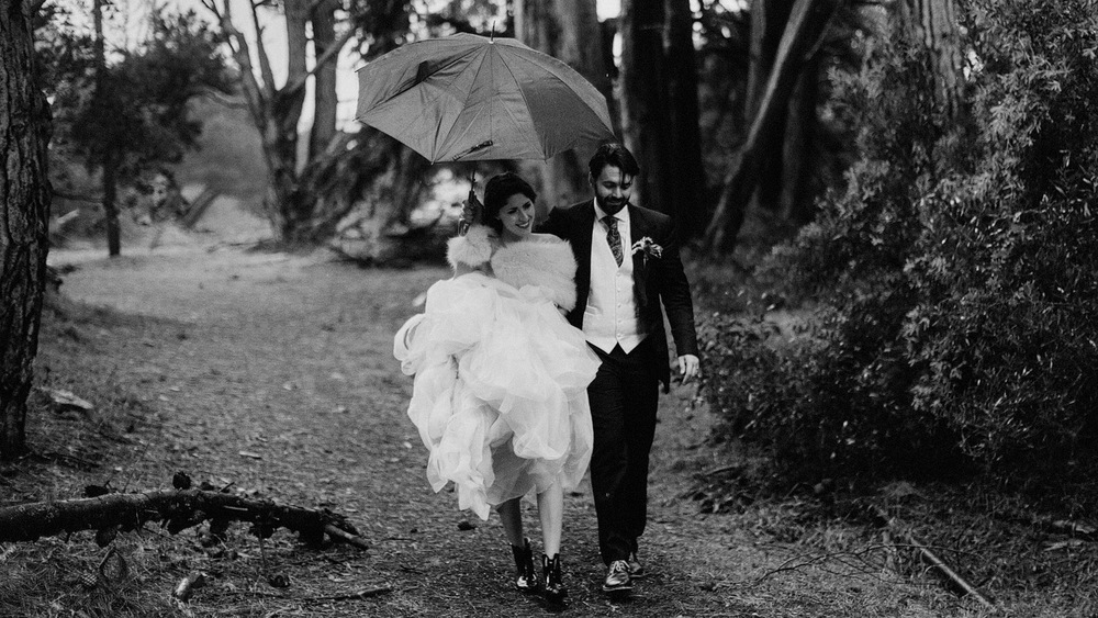 bride and groom walking in rain san francisco california cinemat
