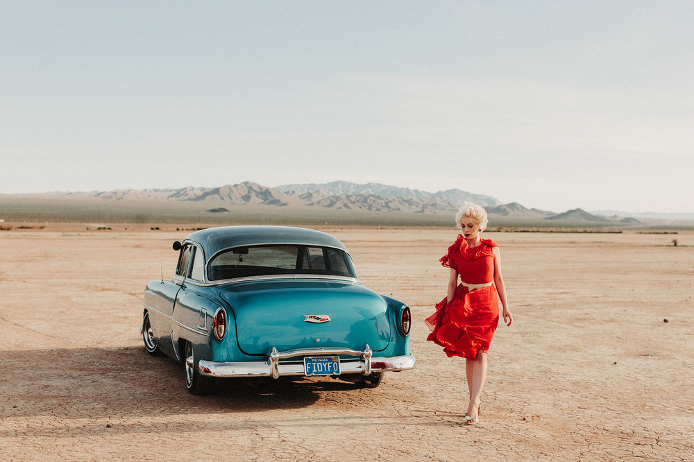 girl with vintage car nevada salt flats
