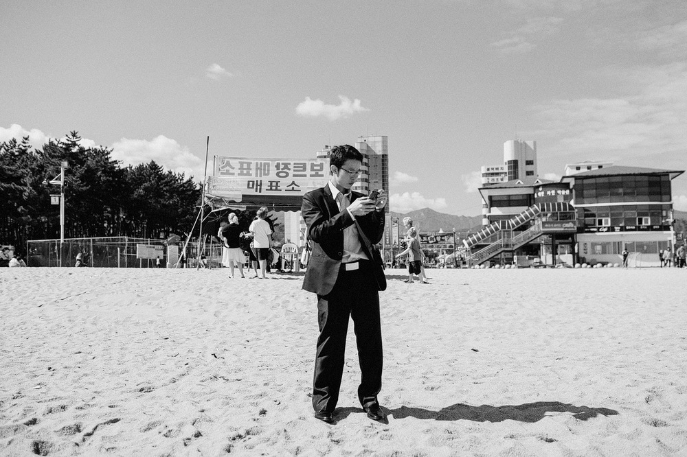 man in suit at beach korea