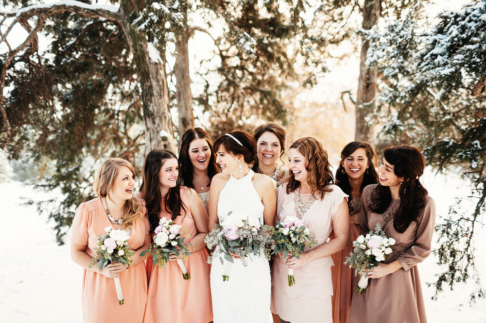 bridal party in snow amazing light laughing fun girls in wedding
