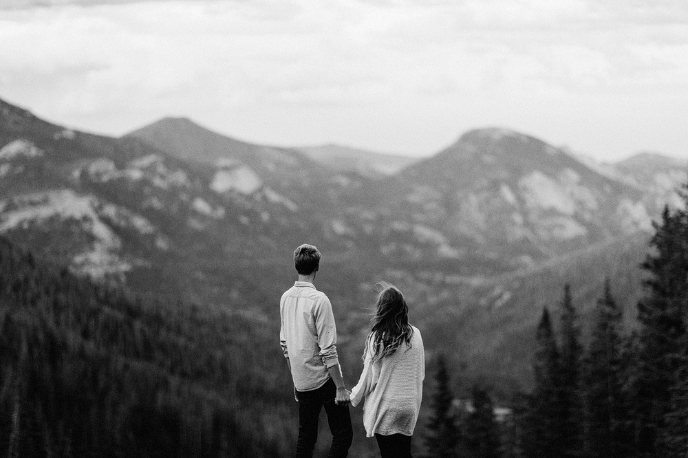 couple overlooking rocky mountains colorado engagement photograp