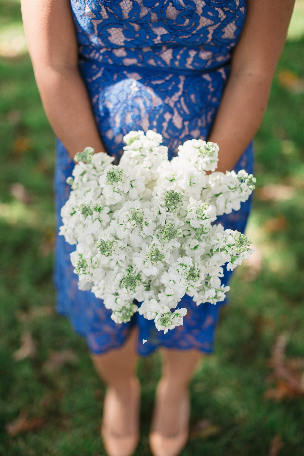 All white stock bouquet with dusty miller.