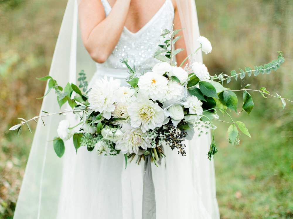 Brides bouquet was filled with dahlias, privet berries, queen anne's lace, ranunculus, wild olive, scabiosa, eucalyptus, foraged greens,  dusty miller, and kochia.