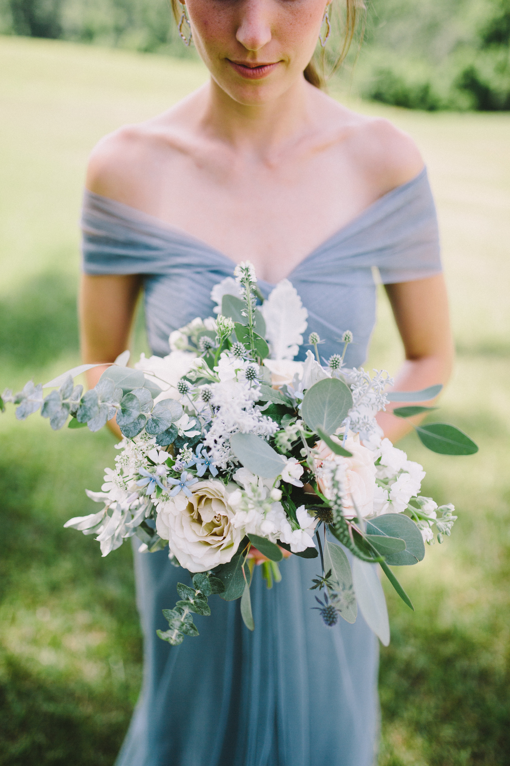 Cream dusty blue summer real wedding petal flower company loads of flowers that had texture made the bouquets pop against the cool bridesmaids dresses and set the stage for a cool summer evening izmirmasajfo