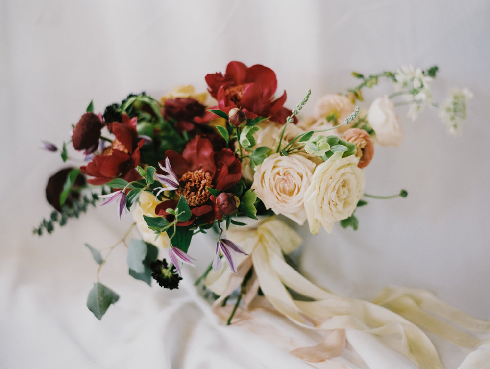 Santara's bouquet was filled with clematis, sahara roses, peonies, lavender, scabiosa, ranunculus, foxglove, hellebore, eucalyptus, and other lovely flowers.