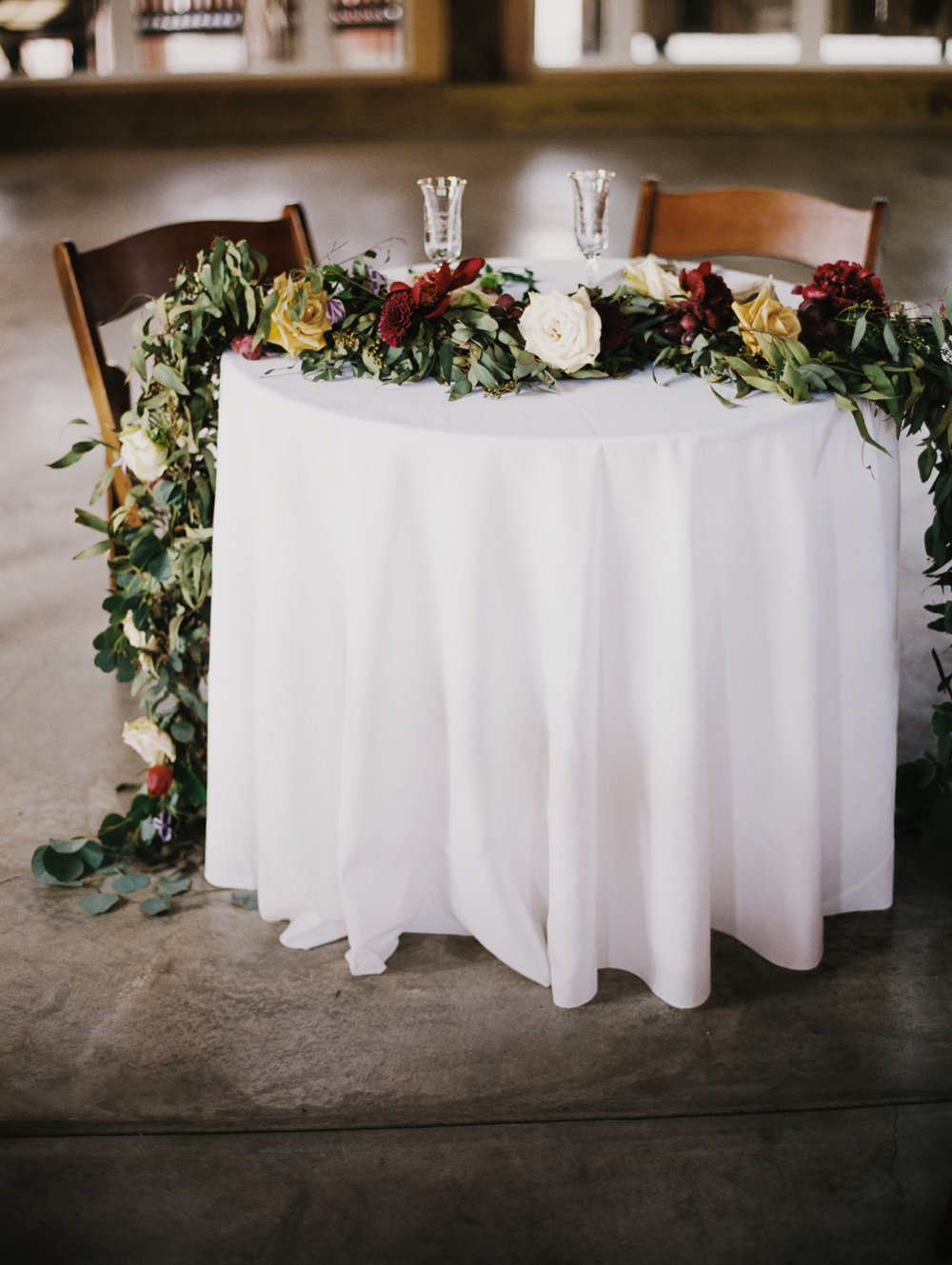 Dwight and Santara's sweetheart table garland.