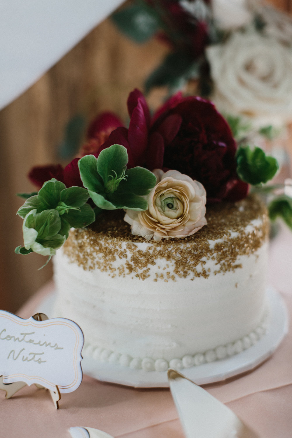 Hellebore, peonies and ranunculus topped this cake.