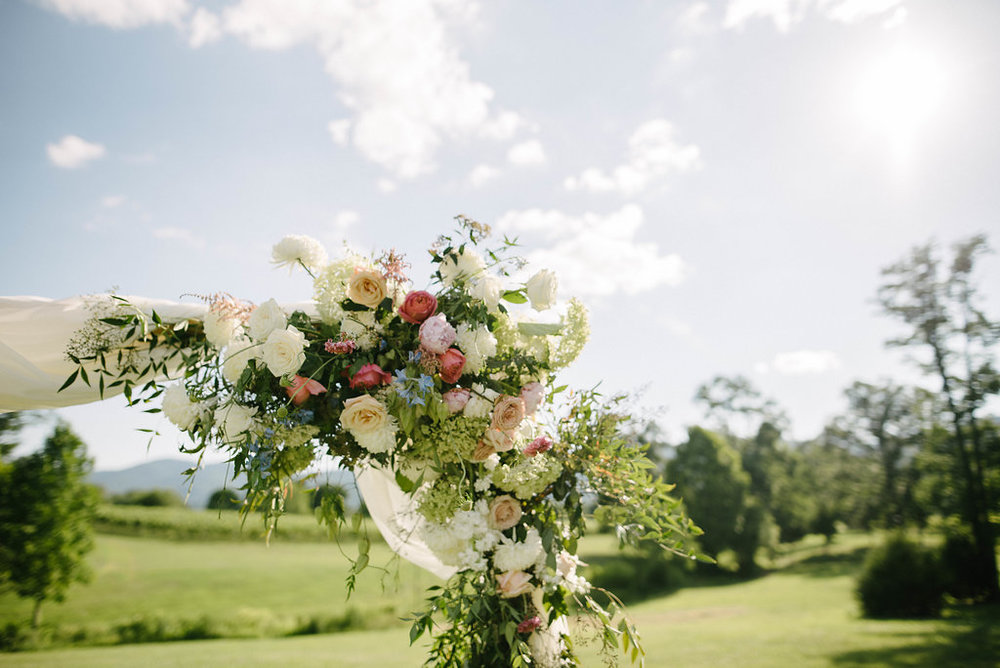 Simple floral wedding arch