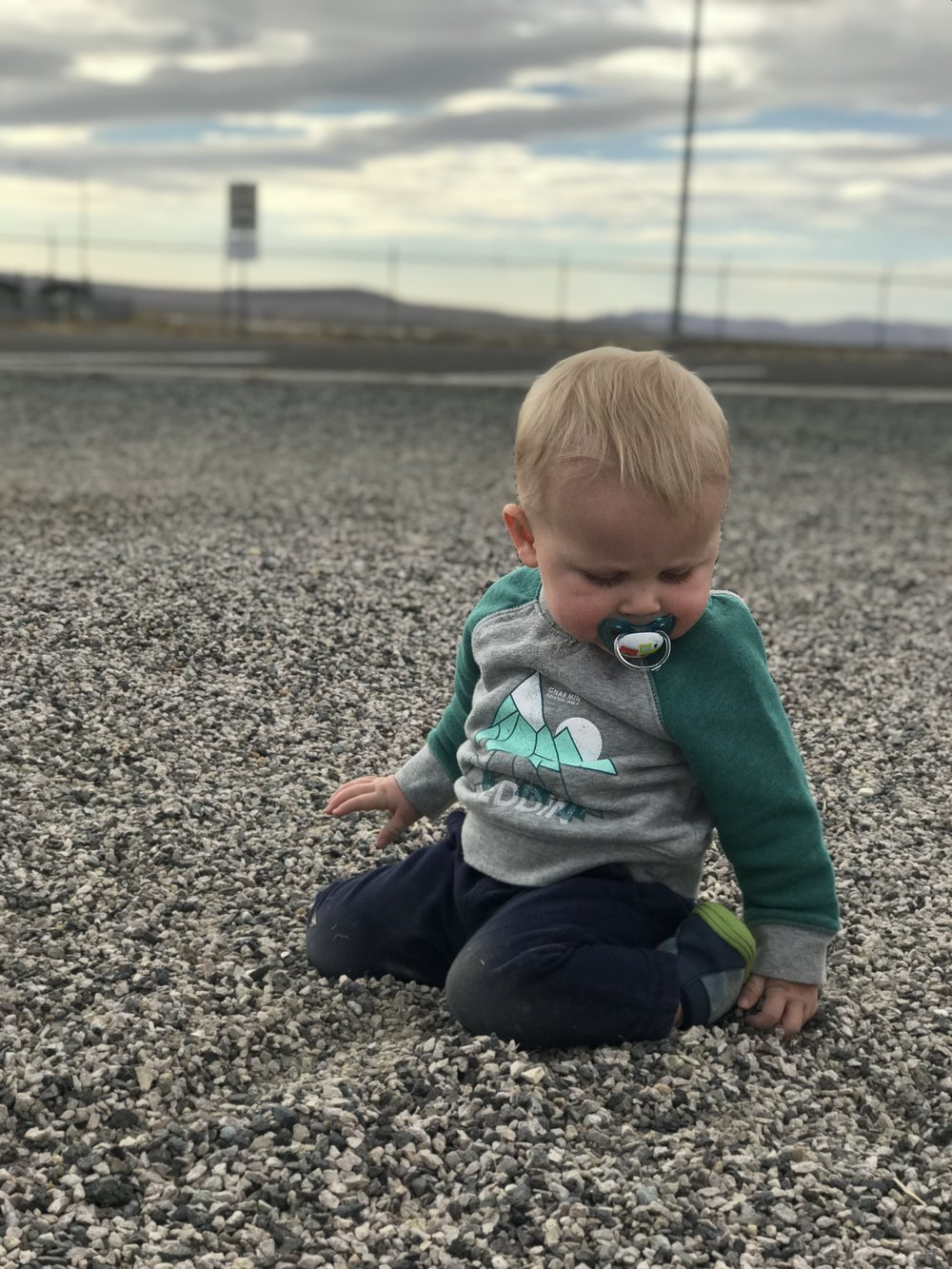 Tommy playing in the gravel at a rest stop