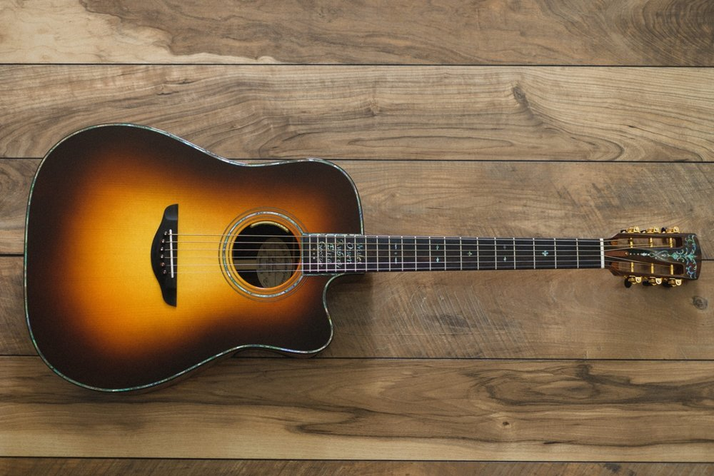 Dreadnought   Can't get anymore classic than a Dreadnought.  Known for it's big and rich sound, that lends well to big strumming and fast bluegrass runs.