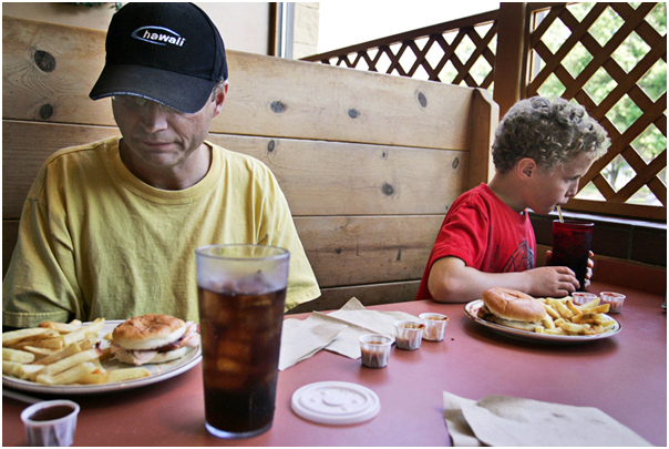 Brent Roper, 45, goes out to eat at Grover's Smokehouse with loved ones, including Noah Phelps-Roper, 9, one of his eight sons. Topeka, KS. 2008.