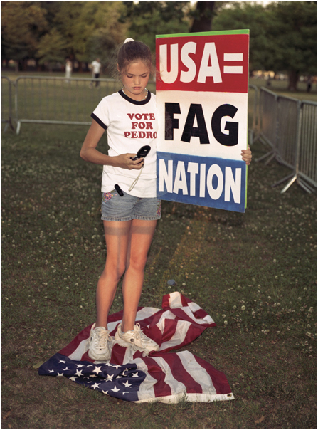 Grace Phelps-Roper stands on flag at Billy Graham crusade picket. Queens, NY 2005.