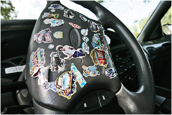 The steering wheel of Elizabeth Phelps' car is decorated with stickers by her son, Daniel, 7. Topeka, KS. 2008.