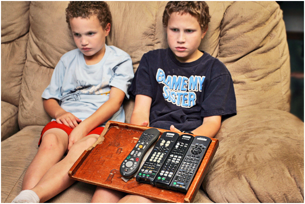 Luke Phelps-Roper, 6, and his brother Jonah, 11, watch television at home while dinner is made. Topeka, KS. 2008.