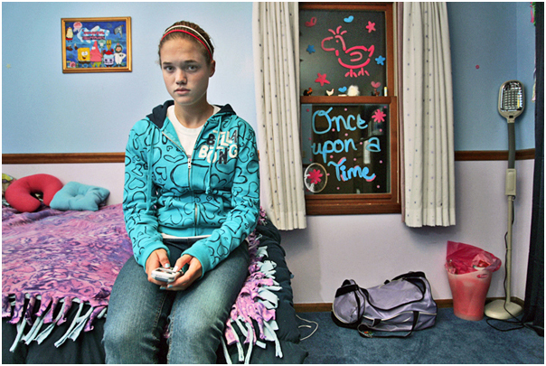 Grace Phelps-Roper, 15, sends text messages in her bedroom. Topeka, KS. 2008.