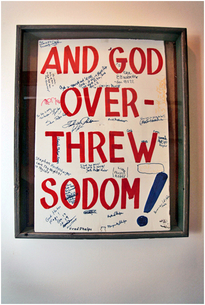 One of the original signs used in protest by Westboro Baptist Church hangs in an upstairs hallway at the Phelps-Roper house. Topeka, KS. 2008.