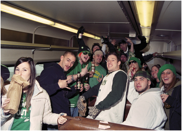 Drunk passengers on 10:00 AM train to St. Patrick's Day parade. Asbury Park, NJ. 2008.