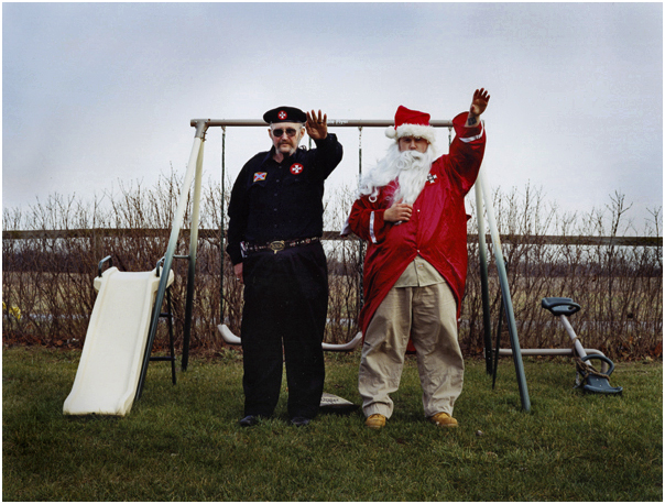 Imperial Wizard Ray Larsen and Ku Klux Klaus salute. Osceola, IN. 2004.