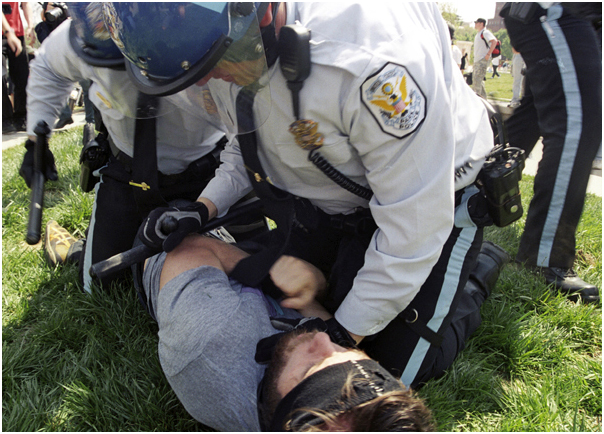 Protestor getting arrested at white power rally counter demonstration. Washington, DC. 2008.