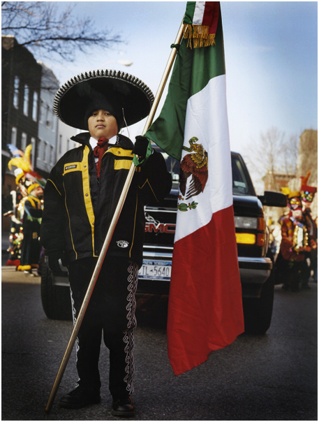 Boy holds Mexican flag during Three Kings parade. Brooklyn, NY. 2005.