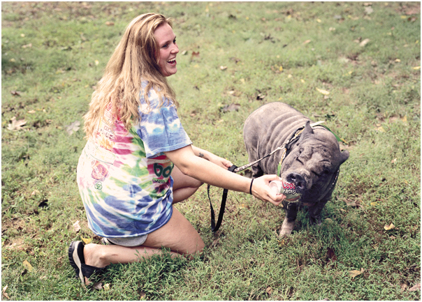 Woman giving her pig Coors Light during Pigfest. Rushland, PA. 2005.