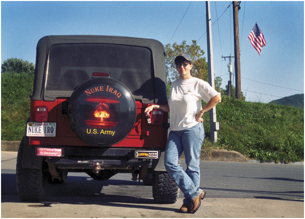 "Woman with her ""Nuke Iraq"" Jeep. Harrisonburg, VA. 2006."