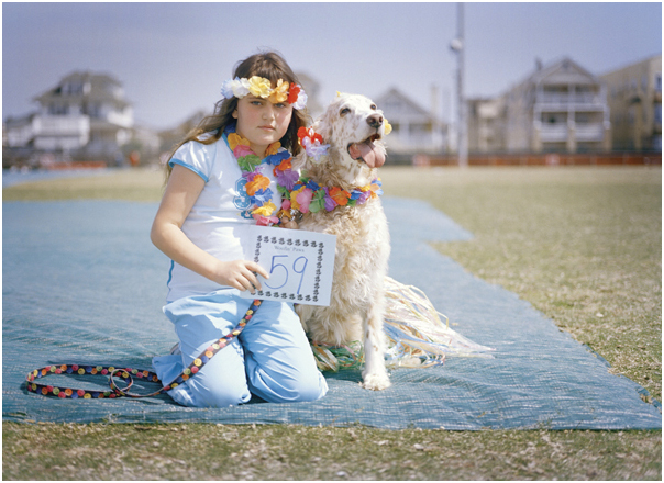 Girl with her dog at pet fashion show. Ocean City, NJ. 2005.