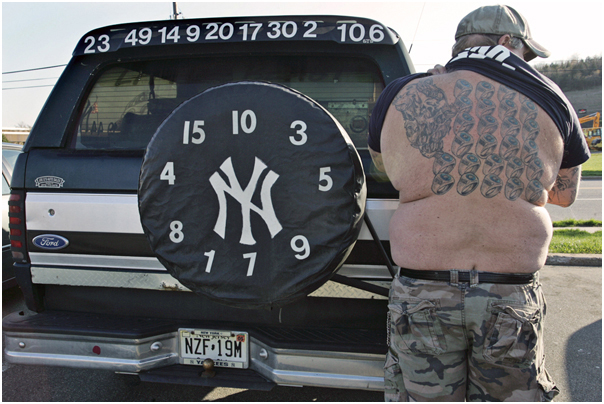 NY Yankee superfan shows ring tattoos outside of ShopRite. Newton, NJ 2010.