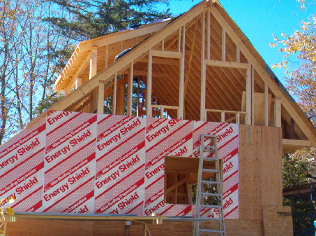 A custom, in-house designed carriage shed with apartment above is being framed and sheathed with energy-efficient sheathing.