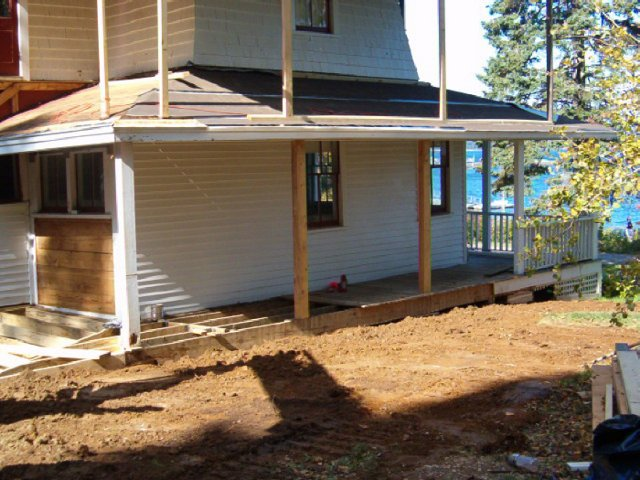 Addition & upper wrap-around porch re-creation on a 100+ year old camp building