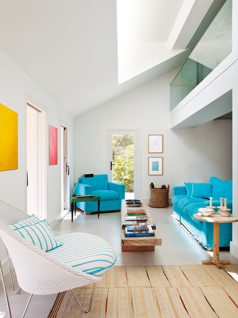 A colorful renovation by the seaside in Mallorca, via  Nuevo Estilo . Loving the bright turquoise linen couch !