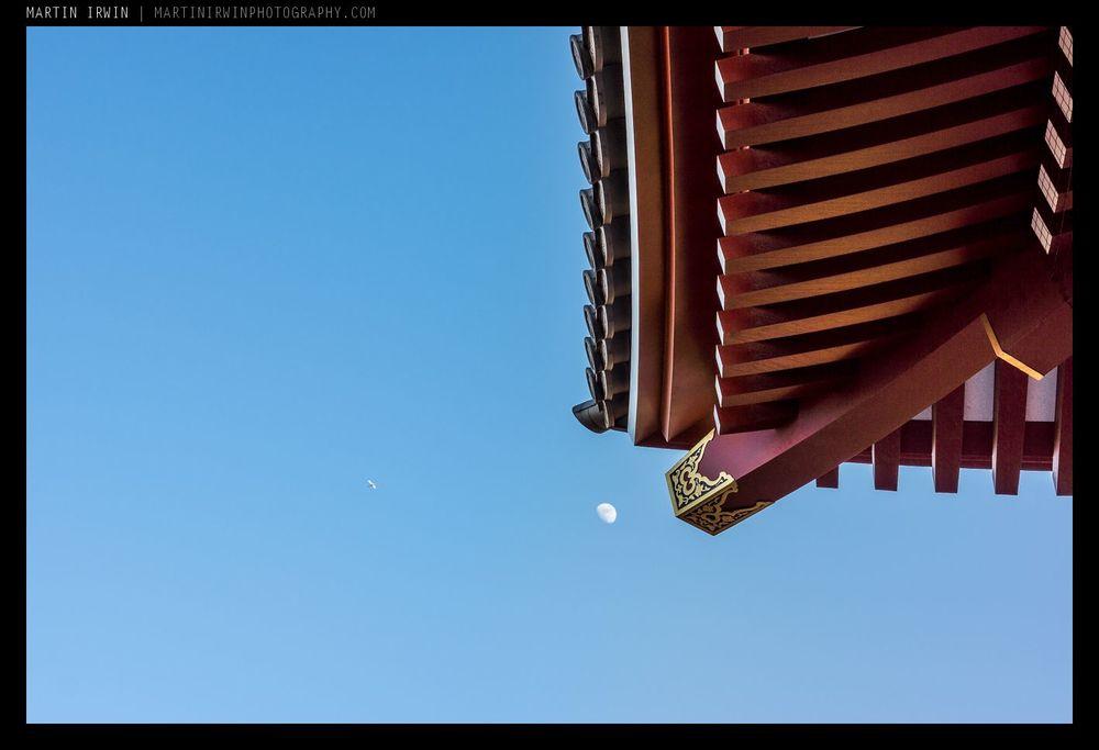 Plane, moon, temple