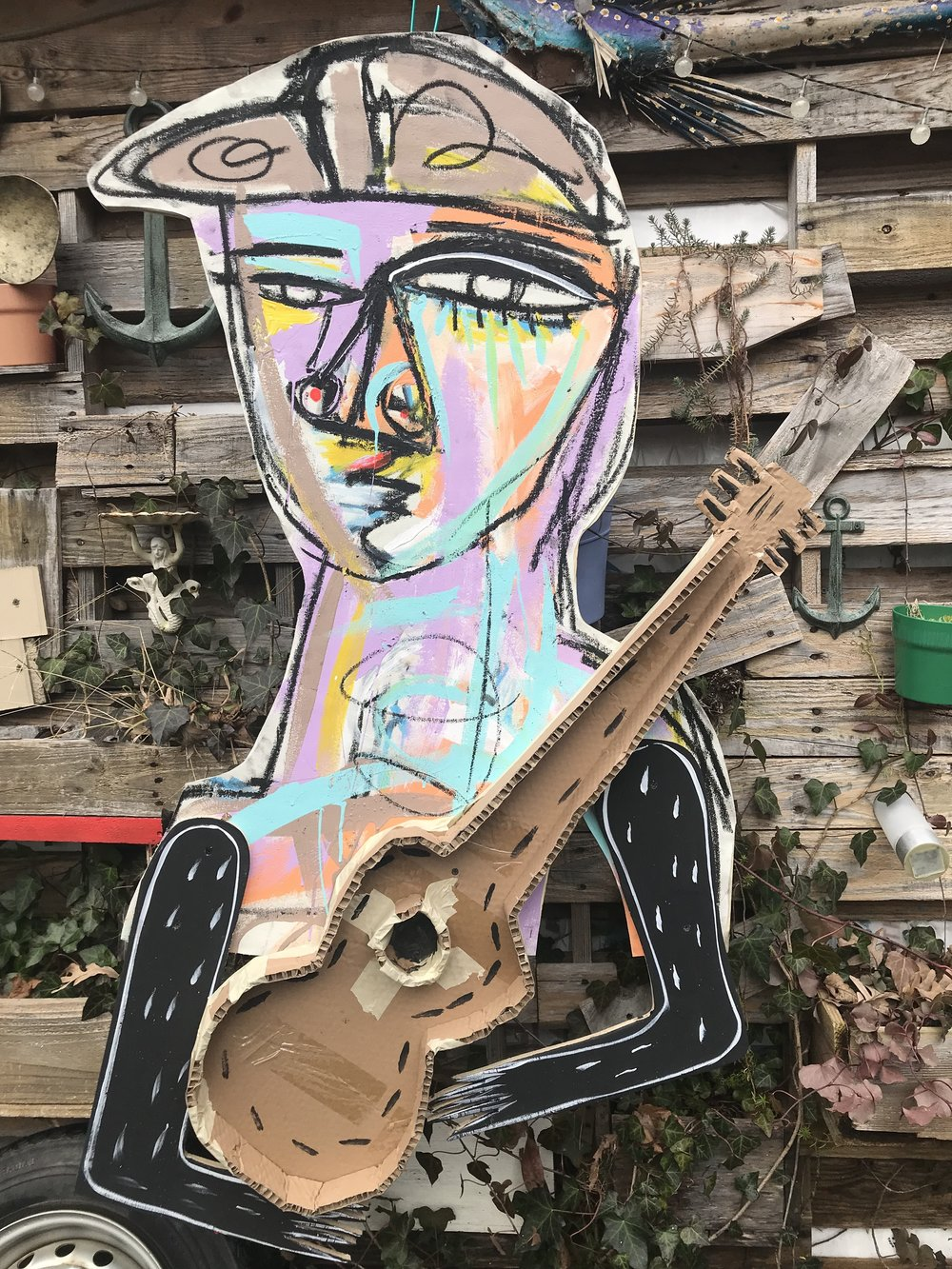 STREET ARTIST 2, CANVAS OVER WOOD CUTOUT WITH CARDBOARD