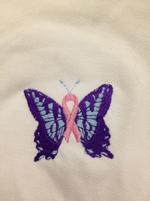 Pink ribbon and butterfly embroidered.