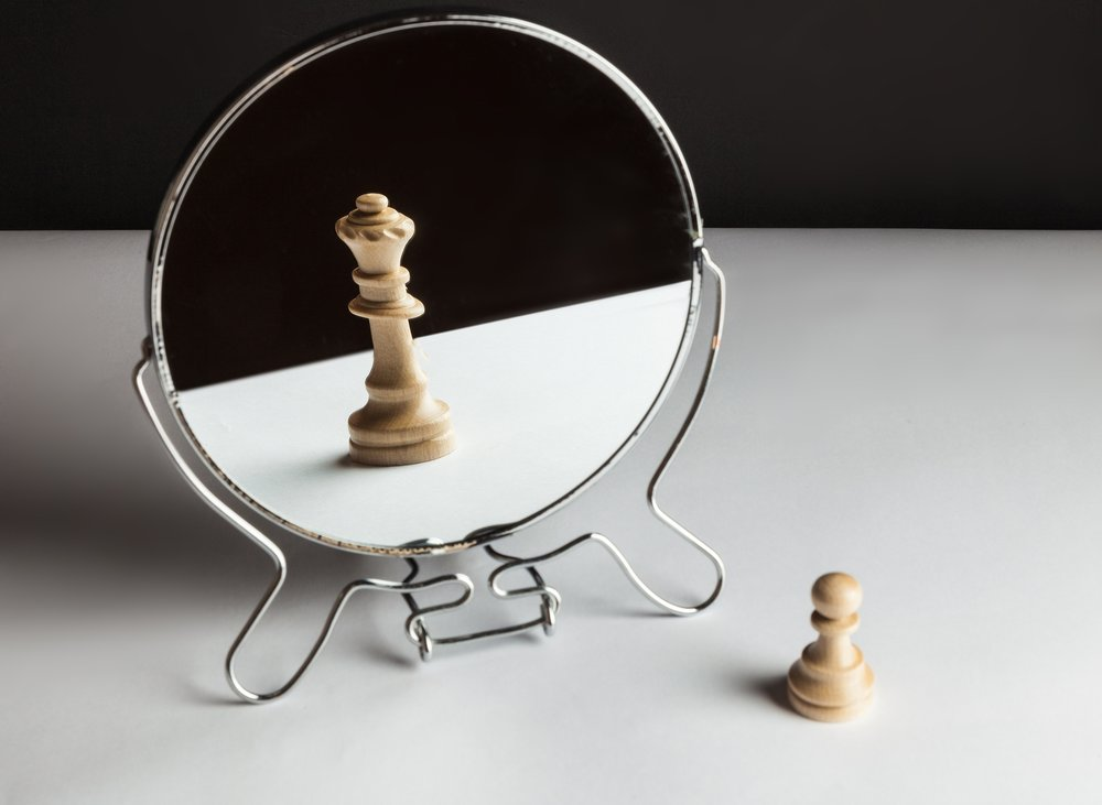 A chess pawn looking in the mirror and seeing a queen.