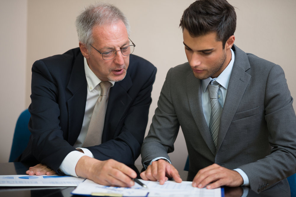 Two professionals analyzing the results of a training evaluation report.