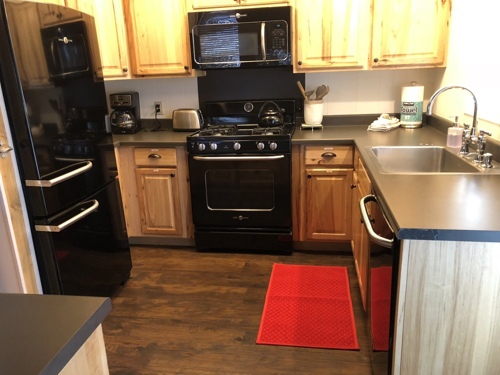 The kitchen has a new mat, a couple broken glasses were replaced, and everything is ready for our next guests.