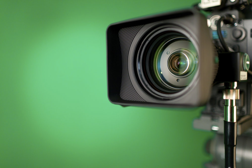 Video camera with a green screen background