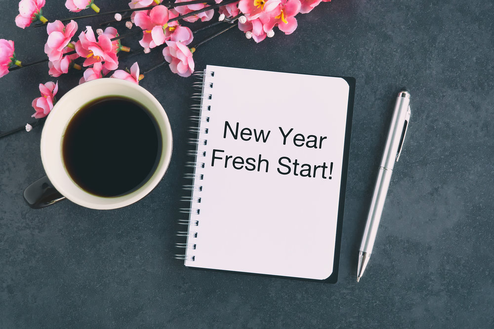"Notepad with ""New Year, fresh start!"" written on it."