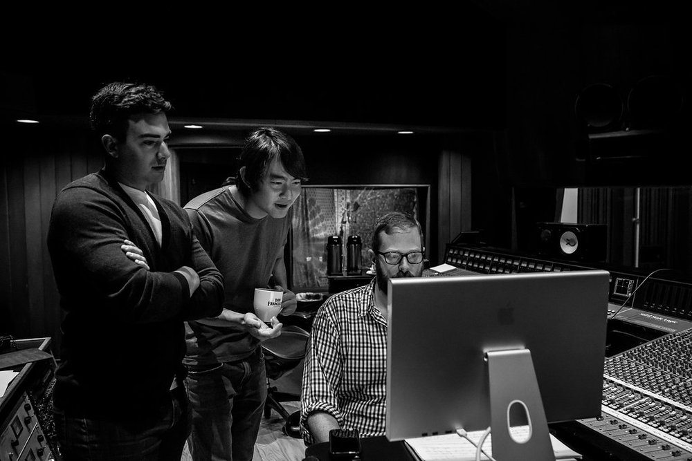 Going over a cue with the composer and engineer.