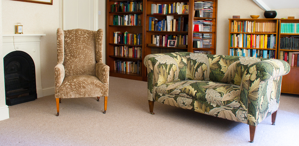 Edwardian drop arm sofa upholstered in William Morris Acanthus tapestry  and Georgian wing chair in classic William Morris velour. It goes to show that you can use more than one pattern on different pieces within the same room.
