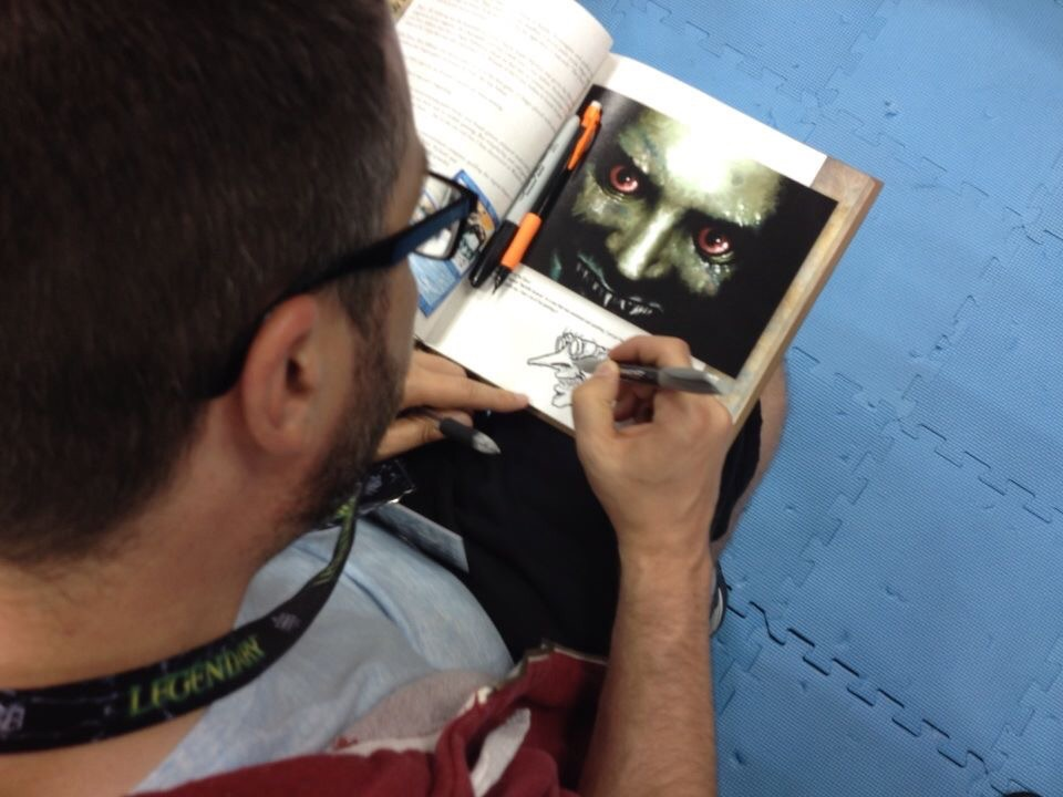 "Dennis signs the kick-ass ""The Gathering"" book for a fan."