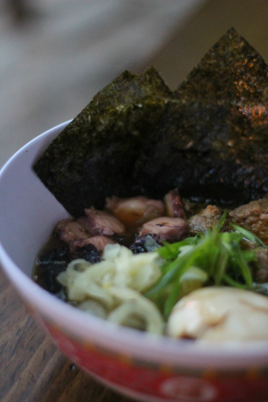 """Mossified"" Ramen Bowl- roast pork, octopus, black garlic dashi, black noodles, tea egg, fennel"
