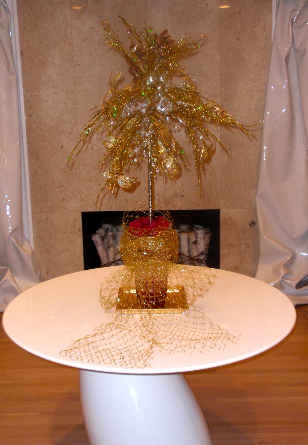 A gold tree in the living room