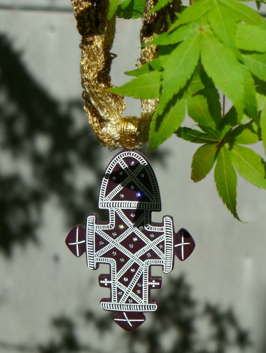 Ethiopian cross in brown with hand crocheted gold chain.