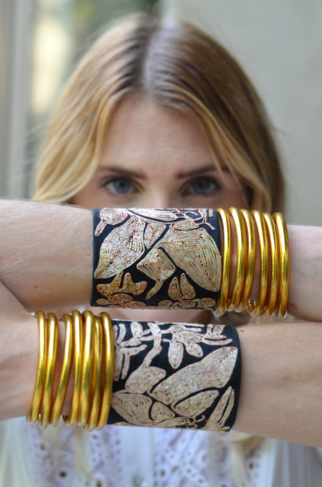 "It is all about cuffs this week. We started the week with our fabulous  Royal Thai Cuff  and now we want to present you with our fabulous  Forbidden Stitch Cuff.   This cuff is created with a singularly beautiful piece of embroidery work originally from ancient China. These stitches are so intricate and delicate, they were named ""Forbidden"" stitches, as very few craftsmen and women were allowed to practice this art. Our  Forbidden Stitch embroidery  is vintage and no longer available; so when these cuffs are gone, there will be no more. This is a very special limited edition piece. Our cuffs are black silk with gold bullion thread.     We love styling our  Forbidden Stitch Cuff  with our  Gold All Weather Bangles  for that luxe and chic look.       Mindful Glamour Ritual:   Pause...Notice a minute element or detail of something around you this moment.       Thought:   Consciously acknowledge the tiny things that hold us all together.     Go. Be, it."