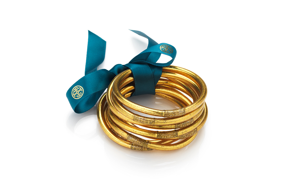 Gold All Weather Bangles  featuring nine bangles for nine daily intentions.