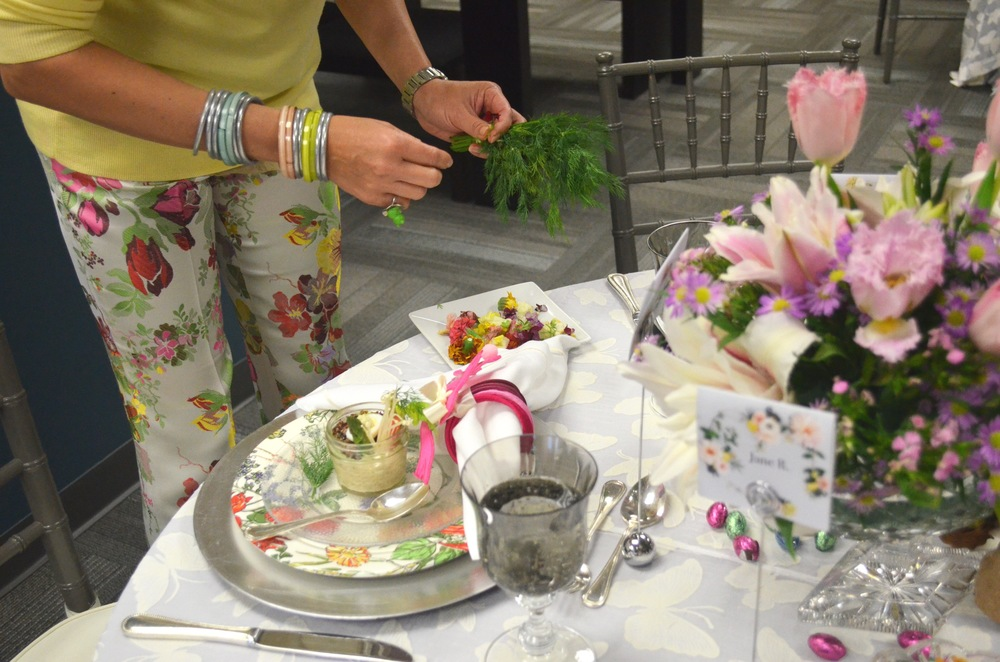 Dill and edible flowers decorate each place setting.